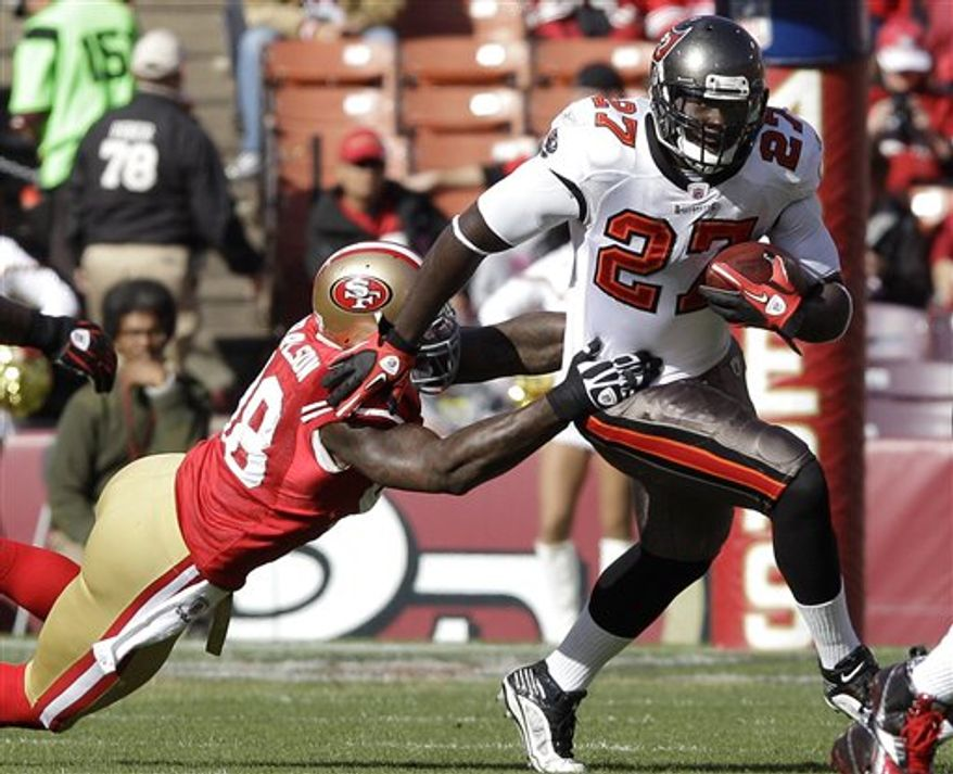 Tampa Bay Buccaneers wide receiver Mike Williams, left, celebrates after scoring on an 8-yard touchdown catch from quarterback Josh Freeman, right, against the San Francisco 49ers in the third quarter of an NFL football game, Sunday, Nov. 21, 2010, in San Francisco. (AP Photo/Paul Sakuma)