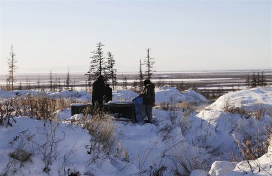 In this Oct. 26, 2010 photo, a tiny chapel is seen on the grounds of the Northeast Science Station near the town of Chersky in Siberia 6,600 kms (4,000 miles) east of Moscow, Russia. Gas locked inside Siberia's frozen soil and under its lakes has been seeping out since the end of the last ice age 10,000 years ago. But in the last few decades, as the Earth has gradually warmed, the icy ground has begun thawing more rapidly, accelerating the release of methane _ a greenhouse gas 23 times more powerful than carbon dioxide _ at a perilous rate. (AP Photo/Arthur Max)