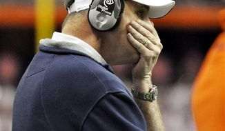 Syracuse head coach Doug Marrone reacts to his teams inability to move the ball against Connecticut during the fourth quarter of an NCAA college football game in Syracuse, N.Y., Saturday, Nov. 20, 2010. Connecticut won 20-6. (AP Photo/Kevin Rivoli)