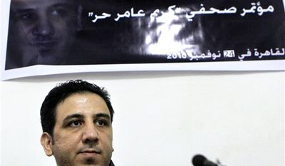 "Egyptian Abdel Kareem Nabil, known by his blogging name of Kareem Amer, during a presser following his release, in Cairo, Egypt, Wednesday, Nov. 24, 2010. A recently released Egyptian blogger who served the longest prison term in the Arab world for his writings says jail was a ""cruel experience"" but his views remain unchanged. Abdel Kareem Nabil, known by his blogging name Kareem Amer, was arrested in March 2006, was convicted of insulting Islam and the president and served four years in prison. He was released on Nov. 16. (AP Photo/Amr Nabil)"
