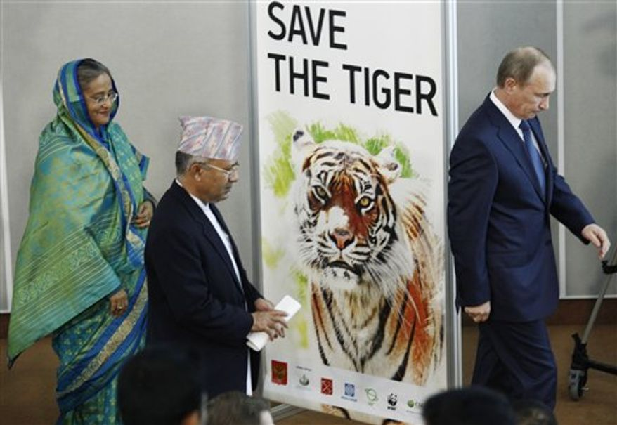 Russian Prime Minister Vladimir Putin, right, Prime Minister of Nepal Madhav Kumar, center, and, Prime Minister of Bangladesh Sheikh Hasina attend the International Tiger Forum in St.Petersburg, Russia, Tuesday, Nov. 23, 2010. (AP Photo/Dmitry Lovetsky)