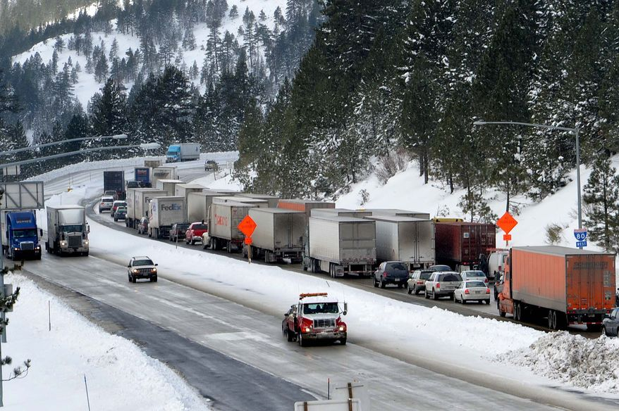 Several trucks and cars headed westbound out of Truckee, Calif., sit in heavy traffic on Interstate 80 on Monday afternoon, Nov. 22, 2010. Chain restrictions were still being enforced over Donner Summit though many truckers chained up miles before. (AP Photo/Reno Gazette-Journal, Tim Dunn)