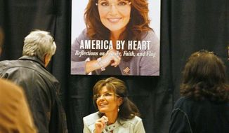 "Sarah Palin greets fans and supporters as she signs her book ""America by Heart,"" during a book signing event at a Barnes & Noble store on Tuesday, Nov. 23, 2010, in Phoenix. (AP Photo/Ralph Freso)"