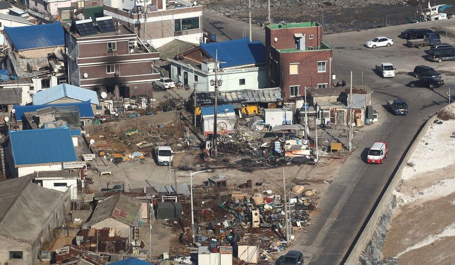 Destroyed houses are evident from the air Wednesday on Yeonpyeong Island, South Korea. Officials say they found the burned bodies of two islanders killed in the North Korean artillery attack, marking the first two civilian deaths in the crisis. (Associated Press/Yonhap)