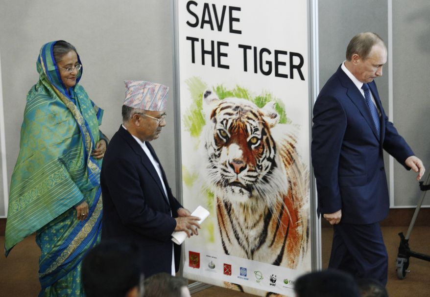 Russian Prime Minister Vladimir Putin, right, Prime Minister of Nepal Madhav Kumar, center, and, Prime Minister of Bangladesh Sheikh Hasina attend the International Tiger Forum in St.Petersburg, Russia, on Tuesday, Nov. 23, 2010. (AP Photo/Dmitry Lovetsky)