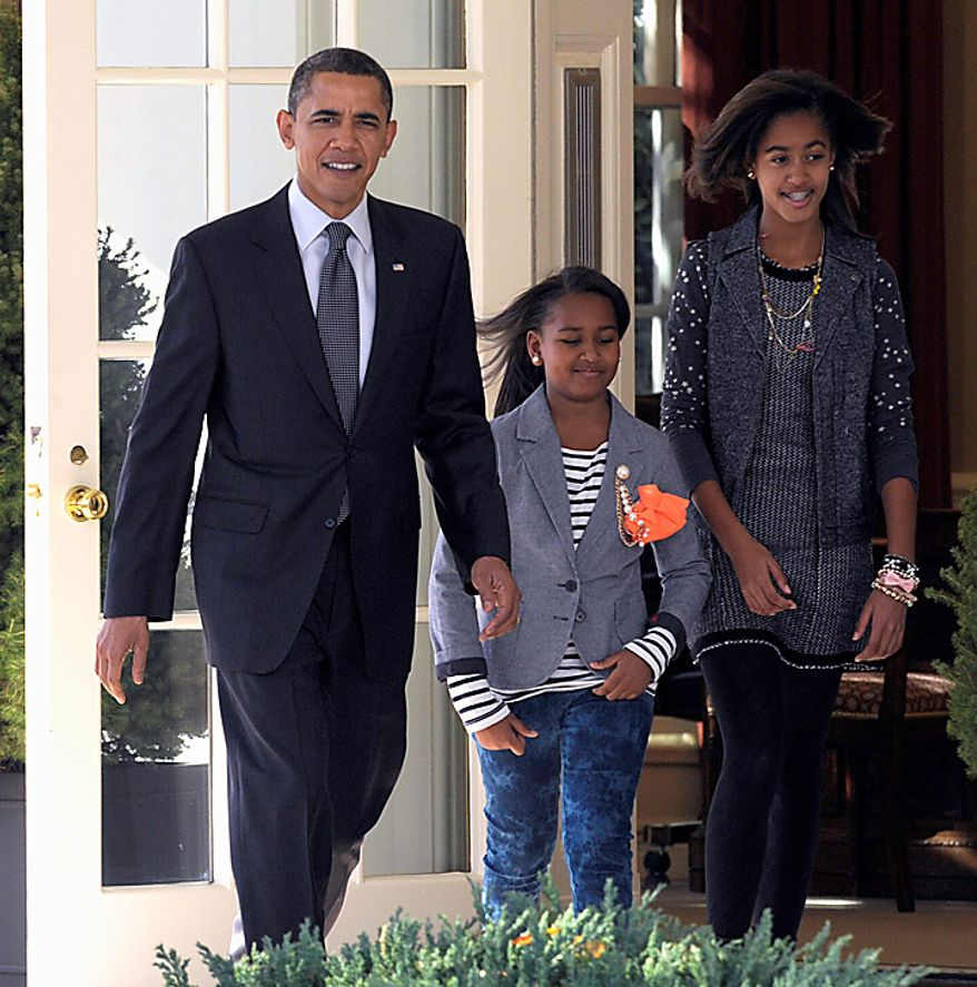 """President Barack Obama and daughters Sasha, center, and Malia, right, walks out of the Oval Office, the Rose Garden of the White House in Washington, Wednesday, Nov. 24, 2010, to participate in an event to pardon """"Apple,"""" the National Thanksgiving turkey during a ceremony. (AP Photo/Susan Walsh)"""