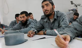 Khan Agha is taking a literacy class as part of the NATO training mission. Only 11 percent of the enlisted personnel in the army and police can read and write, compared with 35 percent for noncommissioned officers and 93 for the officer corps. (Associated Press)