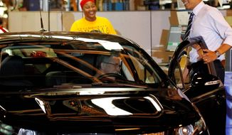 ** FILE ** President Obama inspects a Chevrolet Volt during his tour of the General Motors Auto Plant in Hamtramck, Mich., July, 2012. (Associated Press)
