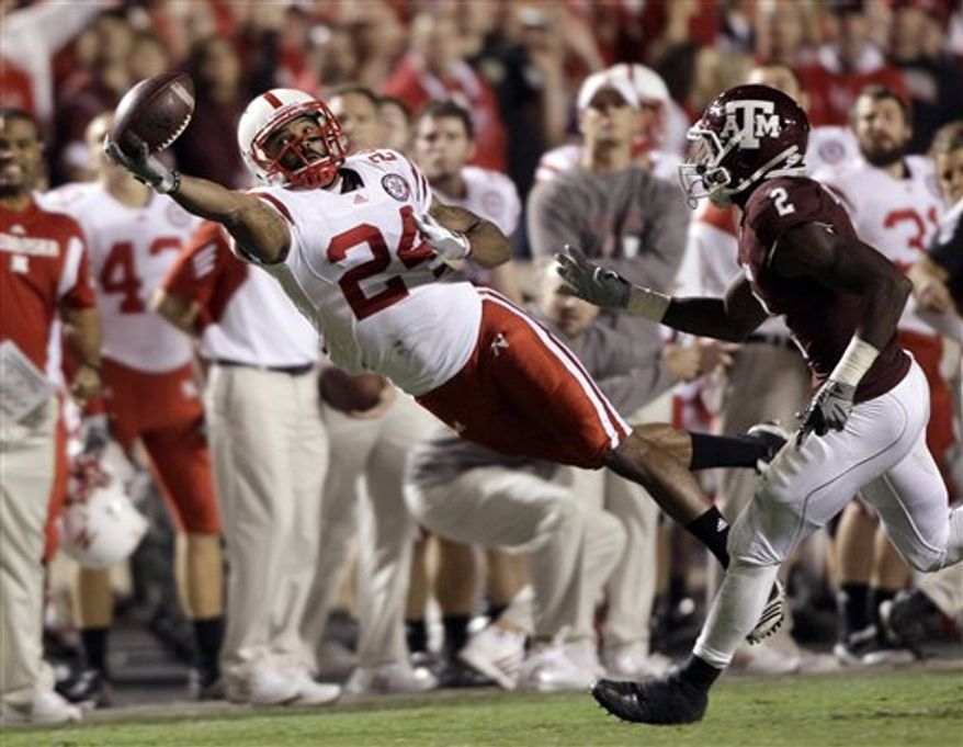 Nebraska Cornhuskers wide receiver Niles Paul (24) reaches for a pass as Texas A&M Aggies cornerback Steven Campbell (2) defends during the second quarter of an NCAA college football game Saturday, Nov. 20, 2010, in College Station, Texas. The pass was incomplete. (AP Photo/David J. Phillip)