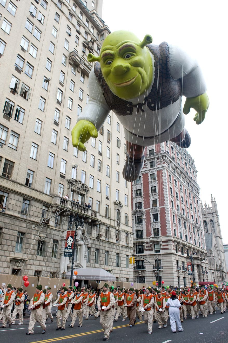 In this Nov. 26, 2009, file photo, the Shrek balloon floats down Central Park West during the Macy's Thanksgiving Day Parade in New York. (AP Photo/Charles Sykes, File)