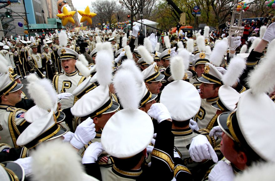 Members of the Purdue University All American Marching Band do a cheer before the start of the Macy's Thanksgiving Day Parade in New York Thursday, Nov. 25, 2010. (AP Photo/Craig Ruttle)