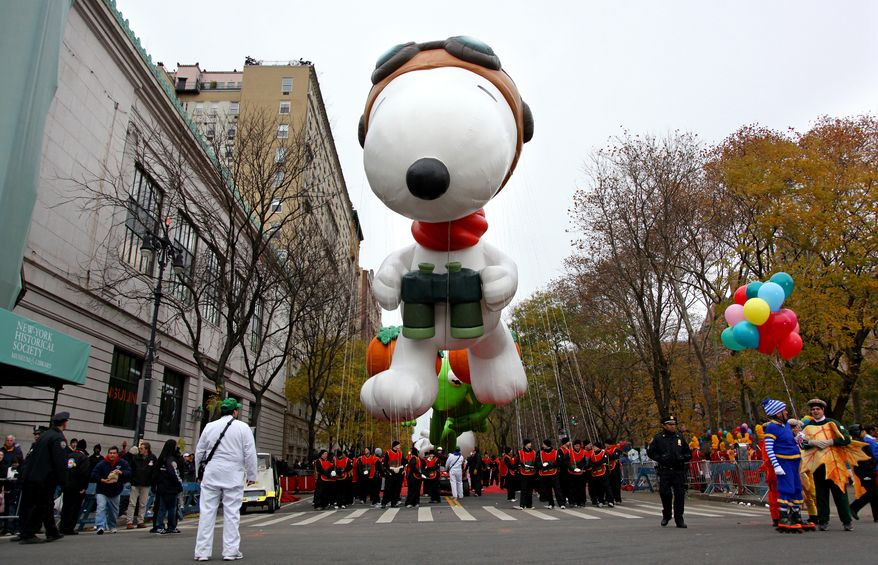 Snoopy floats above the street before the start of the Macy's Thanksgiving Day Parade in New York Thursday, Nov. 25, 2010. (AP Photo/Craig Ruttle)