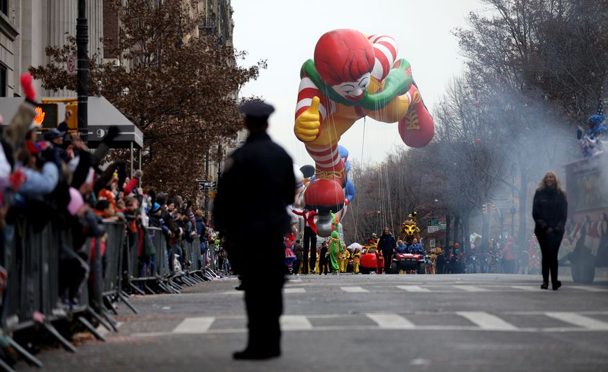 The balloon of character Ronald McDonald floats along Central Park West during the Macy's Thanksgiving Day Parade in New York Thursday, Nov. 25, 2010. (AP Photo/Craig Ruttle)