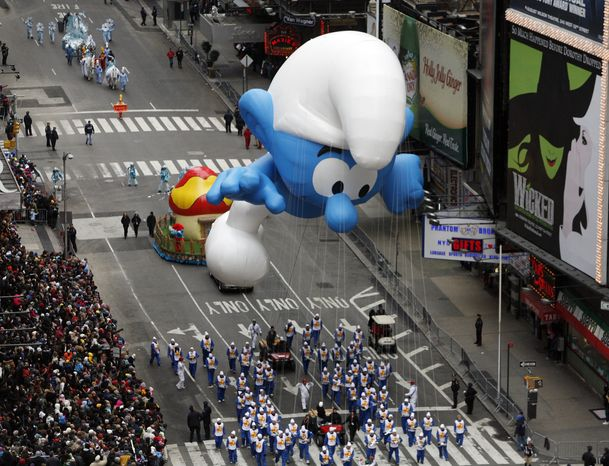 **FILE** The Smurf balloon floats through Times Square during the Macy's Thanksgiving Day parade in New York on Nov. 25, 2010. (Associated Press)