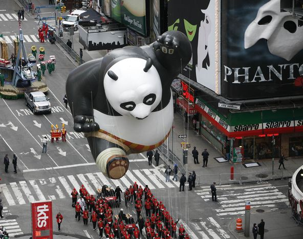 The Kung Fu Panda Balloon floats through Times Square during the Macy's Thanksgiving Day parade in New York, Thursday, Nov. 25, 2010. (AP Photo/