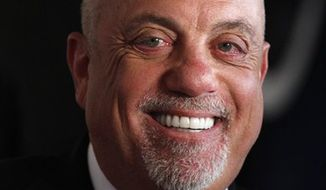 FILE - In this June 17, 2010 file photo, Billy Joel attends the 2010 Songwriters Hall of Fame awards gala in New York. (AP Photo/Peter Kramer, File)