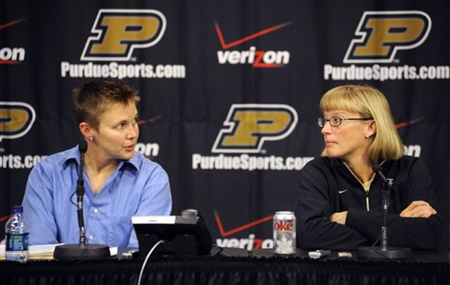 Purdue women's basketball coach Sharon Versyp answers questions about Drey Mingo, who is hospitalized with meningitis, during a news conference Wednesday, Nov. 24, 2010, at Mackey Arena in West Lafayette, Ind. Purdue canceled its trip to a tournament in Mexico. (AP Photo/The Journal & Courier, Brent Drinkut)