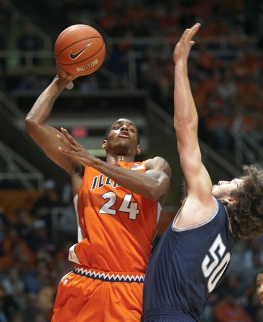 Illinois' Jereme Richmond (22) catches Yale Greg Mangano (44) out of position during the first half of an NCAA college basketball game Tuesday, Nov. 23, 2010, in Champaign, Ill. (AP Photo/Robert K. O'Daniell)
