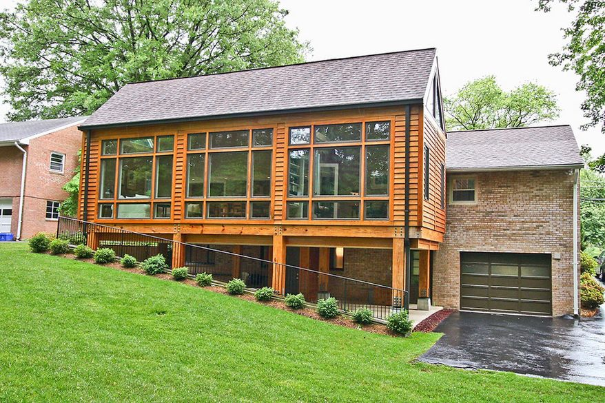 The home at 6418 Noble Drive in McLean is on the market for $1,098,000. An extensive addition that nearly doubles the home's size was built in 2004. A one-car carport is underneath the addition, as is a shaded patio.