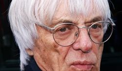 FILE - In this June 20, 2009 file picture, F1 auto racing's supremo Bernie Ecclestone answers questions during free practice in preparation for the British Formula One Grand Prix at the Silverstone racetrack, in Silverstone, England. Formula. Ecclestone  was attacked outside his London office, Wednesday Nov. 24, 2010, and robbed of jewelry worth 200,000 pounds ($314,000).  Ecclestone, 80,  was treated in a hospital with a minor head injury after being punched and kicked by four men after arriving at the offices of Formula One Holdings (AP Photo/ Max Nash, file)