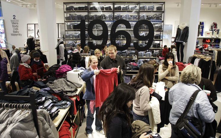Shoppers look for purchases in a Gap store in downtown Seattle on Friday, Nov. 26, 2010. (AP Photo/Ted S. Warren)