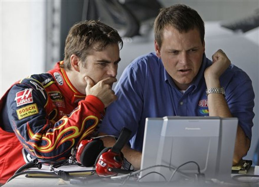 FILE - In this Sept. 23, 2008, file photo, Jeff Gordon, left, talks with crew chief Steve Letarte during a testing session at Lowe's Motor Speedway in Concord, N.C. Hendrick Motorsports made sweeping changes to its organization Tuesday, Nov. 23, 2010, shuffling the lineup for every team except five-time defending champion Jimmie Johnson. Gordon will work with crew chief Alan Gustafson. Letarte will be paired with Dale Earnhardt Jr. (AP Photo/Chuck Burton, File)