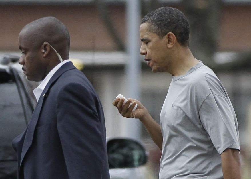 President Barack Obama walks with a U.S. Secret Service agent back to his vehicle after playing a private game of basketball at Fort McNair in Washington on Friday, Nov. 26, 2010. (AP Photo/Charles Dharapak)