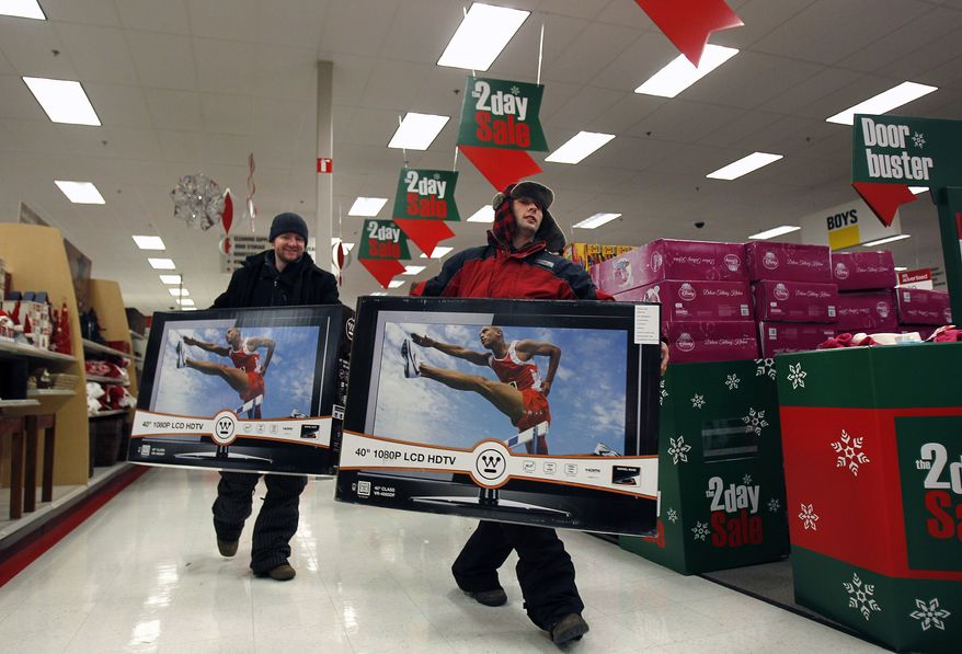 Matt, left, and Josh Weyenberg, of Appleton, Wisc., head for the check-out counter with a pair of 40-inch LCD televisions after the 4 a.m. opening of Target in Grand Chute, Wisc., on Friday Nov. 26, 2010. (AP Photo/The Post-Crescent, Wm. Glasheen)