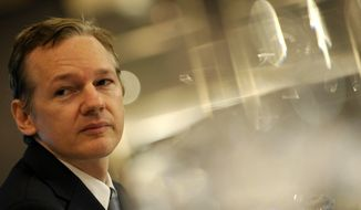 ** FILE ** In this Saturday, Oct. 23, 2010, file picture founder of the WikiLeaks website, Julian Assange, speaks during a press conference in London. (AP Photo/Lennart Preiss/File)
