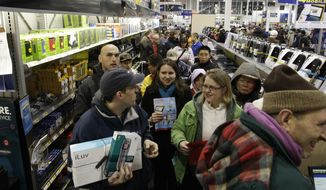"""Crowds of shoppers line up to purchase computers in the early hours of """"Black Friday,"""" Nov. 26, 2010, at Best Buy in Tacoma, Wash. (AP Photo/Ted S. Warren)"""