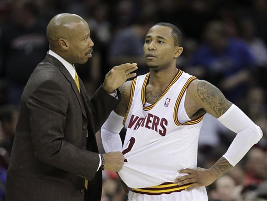 Cleveland Cavaliers coach Byron Scott, left, talks to Mo Williams in the third quarter of an NBA basketball game Wednesday, Nov. 24, 2010, in Cleveland. Williams scored 25 points including a final shot at the end of the game to give the Cavaliers an 83-81 win over the Milwaukee Bucks. (AP Photo/Mark Duncan)