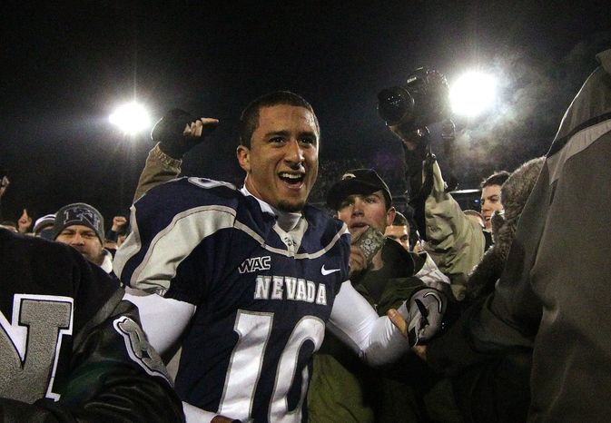 Nevada Wolf Pack quarterback Colin Kaepernick celebrates with fans as he leaves the field after a 34-31 overtime win over Boise State during the NCAA college football game Friday night, Nov. 26, 2010, in Reno, Nev. (AP Photo/Cathleen Allison)