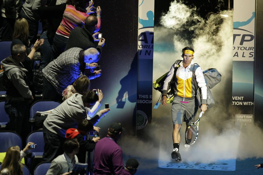Spain's Rafael Nadal arrives to the court to play Britain's Andy Murray in a semifinal single tennis match of the ATP World Tour Finals at O2 Arena in London on Saturday, Nov. 27, 2010. (AP Photo/Sang Tan)