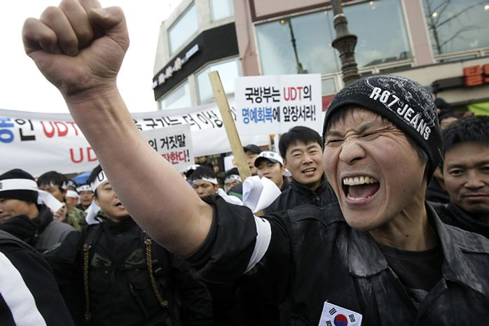 A former South Korean underwater demolition team member shouts a slogan during an anti-government rally in front of the Defense Ministry in Seoul, South Korea, Saturday, Nov. 27, 2010. (Photo: Associated Press)