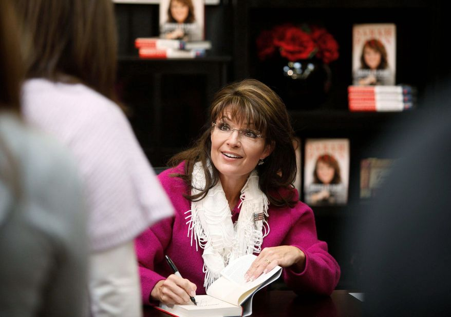 """Associated Press Former Alaska Gov. Sarah Palin signs a copy of her new book """"America by Heart"""" in Andover, Kan., on Sunday. The day before, she was in Iowa, the site in January 2012 of the first presidential caucuses."""