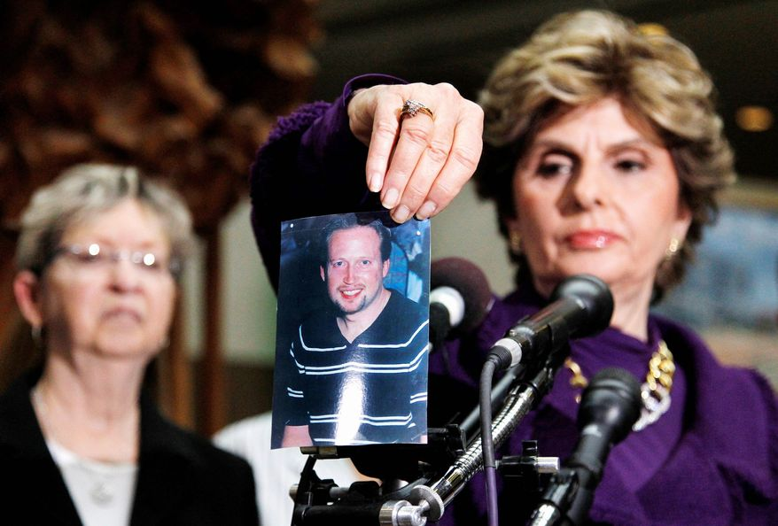 Associated Press At a news conference Tuesday in Rockville, Md., Gloria Allred, attorney for the family of homicide victim Brian Betts, displays a photo of the one-time principal of a D.C. middle School who was killed in his Silver Spring, Md., home.