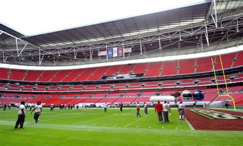 FILE - In this Oct. 30, 2010, file photo, the San Francisco 49ers work out during an NFL football pracrice at Wembley Stadium, London. The NFL fined the Denver Broncos and coach Josh McDaniels $50,000 each because the team's video operations director broke league rules by filming a San Francisco 49ers practice in London last month. (AP Photo/Tom Hevezi, File)