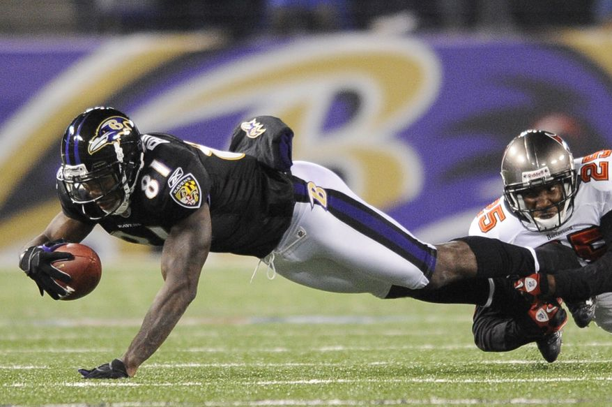 Baltimore Ravens wide receiver Anquan Boldin (81) is tackled by Tampa Bay Buccaneers cornerback Aqib Talib (25) after a pass reception during the second half of an NFL football game, Sunday, Nov. 28, 2010, in Baltimore. (AP Photo/Nick Wass)