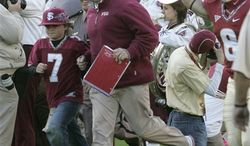 Florida coach Urban Meyer looks up at the scoreboard as time runs out in the fourth quarter of an NCAA college football game against Florida State on Saturday, Nov. 27, 2010 in Tallahassee, Fla. Florida State won 31-7. (AP Photo/Steve Cannon)
