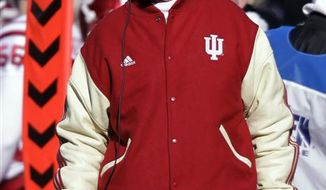 Indiana head coach Bill Lynch watches from the sidelines as his team plays Purdue during the first half of an NCAA college football game in West Lafayette, Ind., Saturday, Nov. 27, 2010. Indiana defeated Purdue 34-31 in overtime. (AP Photo/Michael Conroy)