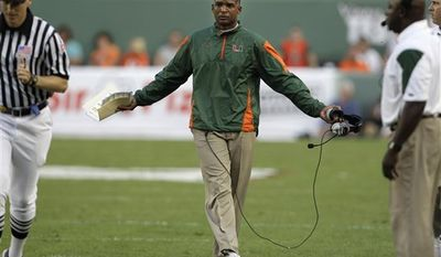 In this photo taken Nov. 20, 2010, Miami head coach Randy Shannon argues a call with a referee during an NCAA college football game against Virginia Tech in Miami.  Miami fired  Shannon on Saturday night Nov. 27, 2010, hours after the Hurricanes finished a 7-5 regular season that began with championship expectations. Miami lost to South Florida 23-20 in overtime. (AP Photo/Lynne Sladky)