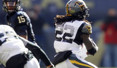 West Virginia running back Noel Devine (7) gets by a diving Pittsburgh linebacker Max Gruder (55) on a long run to the 2-yard-line to set up a West Virginia touchdown during the the second quarter of an NCAA college football game, Friday, Nov. 26, 2010 in Pittsburgh. (AP Photo/Keith Srakocic)