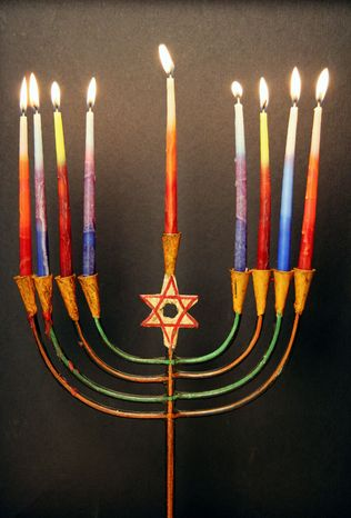 ASSOCIATED PRESS Jews use the menorah to help celebrate Hahukkah, which is separate from Christmastime this year. The eight days of lighting candles, saying prayers and eating latkes begins Wednesday.