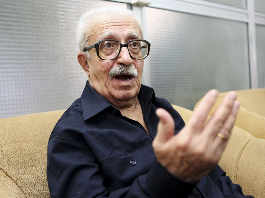 ** FILE ** Tariq Aziz, Saddam Hussein's longtime foreign minister, speaks to the Associated Press in Baghdad in September 2010. An Iraqi court on Monday convicted Aziz of terrorizing Shi'ite Kurds during the Iran-Iraq war and sentenced him to 10 years in prison. (AP Photo/Hadi Mizban, File)