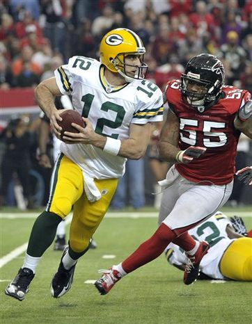 Atlanta Falcons running back Michael Turner (33) scores a fourth-quarter touchdown against the Green Bay Packers in an NFL football game at the Georgia Dome in Atlanta on Sunday, Nov. 28, 2010. (AP Photo/Dave Martin)