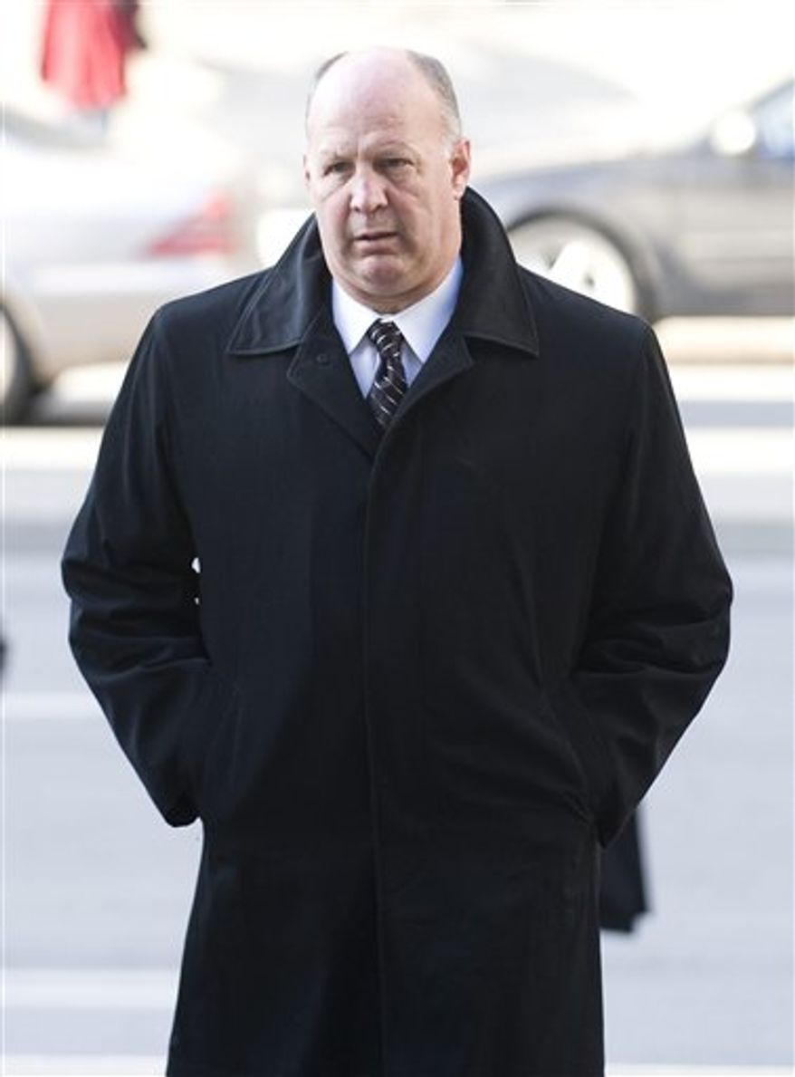 Boston Bruins head coach Claude Julien attends the funeral of former NHL coach Pat Burns in Montreal, Monday, Nov. 29, 2010.(AP Photo/The  Canadian Press, Graham Hughes)