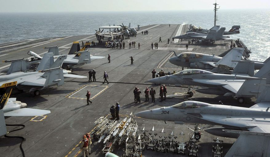 U.S. Navy Carrier Air Wing Five aircraft are tied down on the flight deck of the USS George Washington during joint military drills with South Korean forces off that country's west coast on Monday, Nov. 29, 2010. (AP Photo/Korea Pool)
