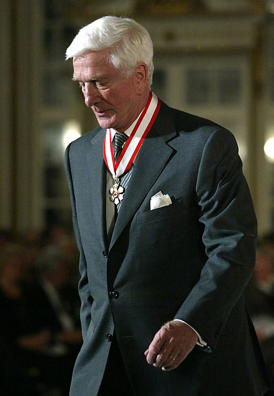 In this file photo taken Dec. 12, 2003, actor Leslie Nielsen walks off stage after receiving the Order of Canada from Governor General Adrienne Clarkson during a ceremony in Ottawa. The Canadian-born Nielsen, 84, has died in a Florida hospital on Sunday, Nov. 28, 2010, according to his agent John S. Kelly. (AP Photo/The Canadian Press, Jonathan Hayward, File)