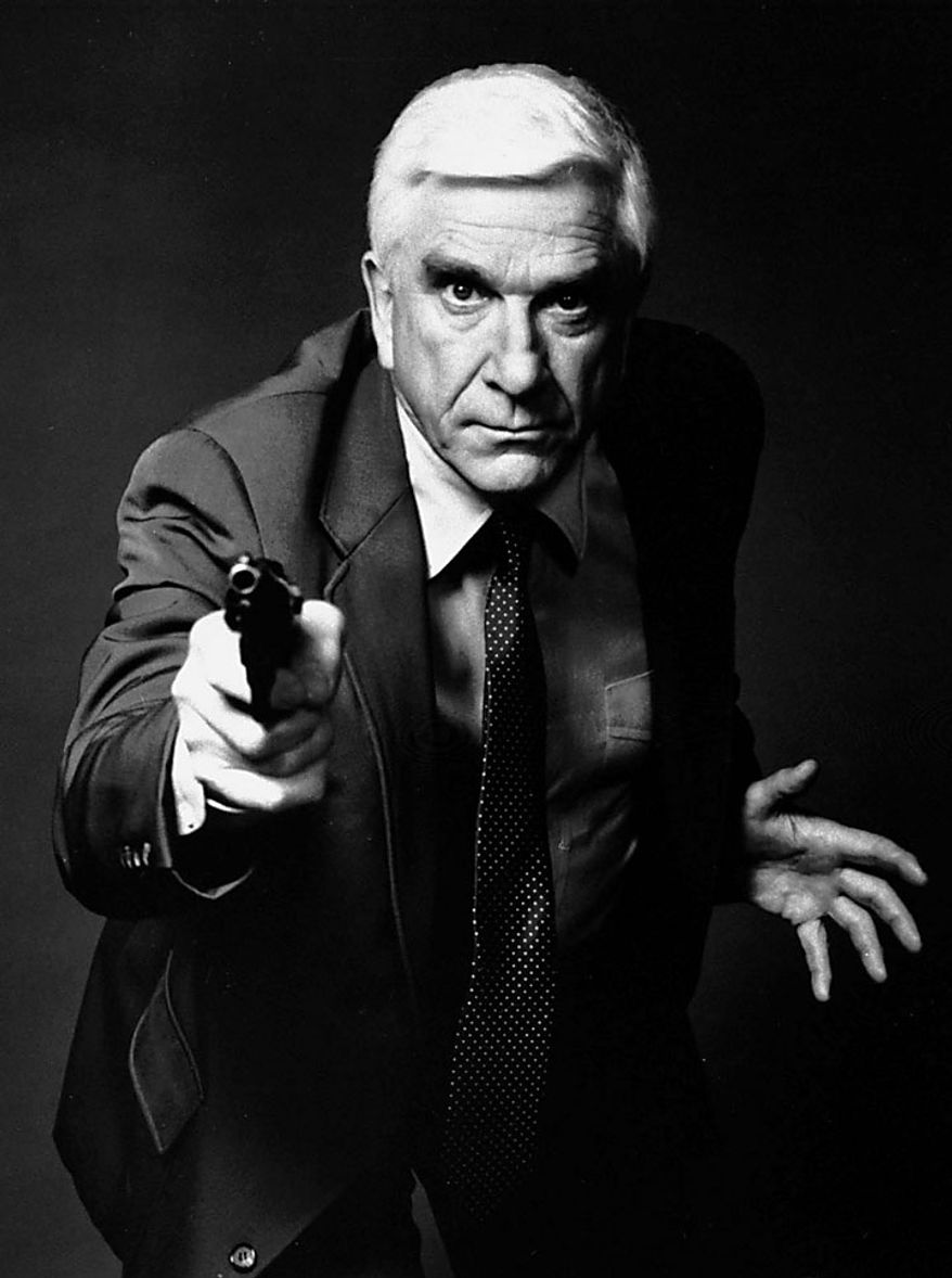 "This 1988 file photo provided by Paramount, shows actor Leslie Nielsen as Lt. Frank Drebin in the movie ""The Naked Gun: From the Files of Police Squad!"" The Canadian-born Nielsen, who went from drama to inspired bumbling as a hapless doctor in ""Airplane!"" and the accident-prone detective Frank Drebin in ""The Naked Gun"" comedies, has died. He was 84. His agent John S. Kelly said the actor died Sunday, Nov. 28, 2010, at a hospital near his home in Florida where he was being treated for pneumonia. (AP Photo/Paramount, File)"