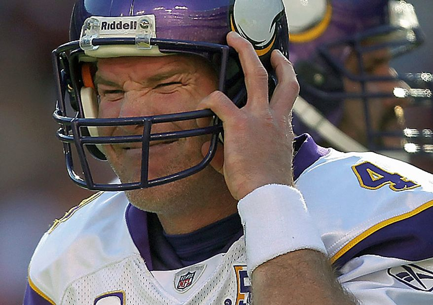 Minnesota Vikings quarterback Brett Favre pulls on his helmet after it was knocked off during the first half of an NFL football game against the Washington Redskins in Landover, Md., Sunday, Nov. 28, 2010. (AP Photo/Pablo Martinez Monsivais)